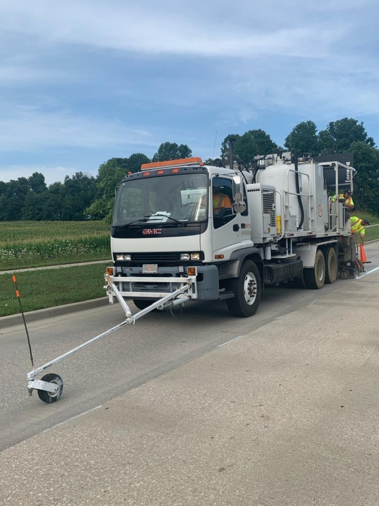 Paint truck adds white highway line